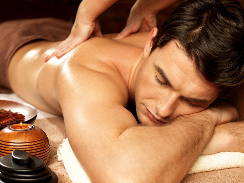 Man having back massage in the spa salon